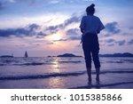 women standing see the beach... | Shutterstock . vector #1015385866