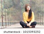 beauty asian woman in yellow... | Shutterstock . vector #1015393252