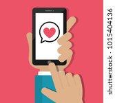 hand holding mobile phone. send ... | Shutterstock .eps vector #1015404136
