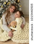sister teenager boy with teddy... | Shutterstock . vector #1015440505
