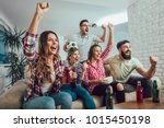 happy friends or football fans... | Shutterstock . vector #1015450198
