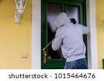 burglar on a doorstep | Shutterstock . vector #1015464676