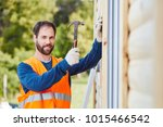 craftsman building new house... | Shutterstock . vector #1015466542