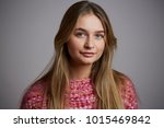 Small photo of Sweater girl with blue eyes, studio