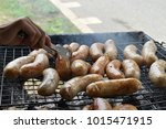 many sausages on grilled grill... | Shutterstock . vector #1015471915