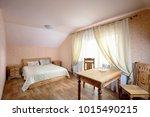 rural hostel room with wooden... | Shutterstock . vector #1015490215