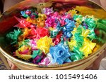 Small photo of Colorful almsgiving ribbon-flowers