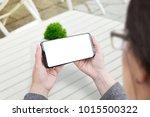 woman holding smart phone in... | Shutterstock . vector #1015500322