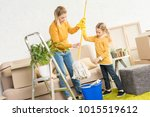 mother and daughter holding mop ... | Shutterstock . vector #1015519612