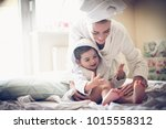 mother have play with her... | Shutterstock . vector #1015558312