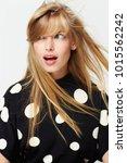 windswept blond woman in... | Shutterstock . vector #1015562242