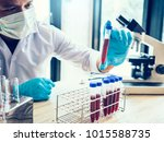 scientist hand holding a test... | Shutterstock . vector #1015588735