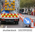 london street barricaded with... | Shutterstock . vector #1015592032