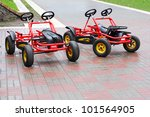 two red four wheeled bicycles... | Shutterstock . vector #101564905