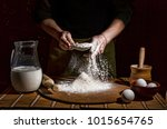 man preparing bread dough on... | Shutterstock . vector #1015654765