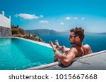 man relaxing in infinity... | Shutterstock . vector #1015667668
