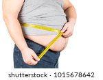 thick mature man measuring... | Shutterstock . vector #1015678642