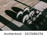 dumbbell at fitness gym to... | Shutterstock . vector #1015686256