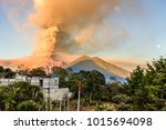 fuego volcano erupting at dawn... | Shutterstock . vector #1015694098