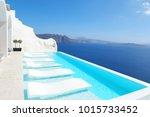 empty infinity pool santorini | Shutterstock . vector #1015733452