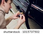a man hands repair left door... | Shutterstock . vector #1015737502