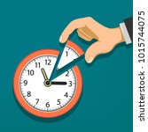 human hand holds the clock with ... | Shutterstock . vector #1015744075