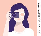 a woman and a camera.... | Shutterstock .eps vector #1015762576