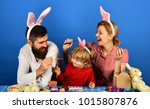 family members painting eggs on ... | Shutterstock . vector #1015807876