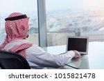 saudi arab man watching laptop... | Shutterstock . vector #1015821478