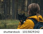 Stock photo a photograph of a girl who is on a hike with her cat 1015829242