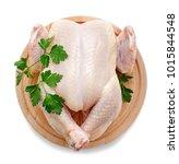 Raw Chicken On Wooden Cutting...