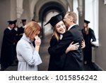 parents congratulate the... | Shutterstock . vector #1015856242
