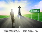 Businessman walking on the highway road going up as an arrow, symbolizing as the way to gain success - stock photo