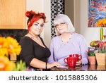 mother and daughter stand in... | Shutterstock . vector #1015885306