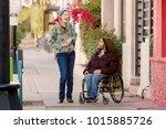 woman talking with friend in...   Shutterstock . vector #1015885726