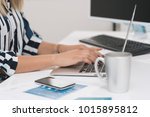 woman's hands typing on a... | Shutterstock . vector #1015895812