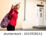 Happy Senior Woman Looking...