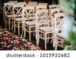 wooden chairs are decorated... | Shutterstock . vector #1015932682