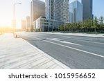 empty asphalt road near glass...   Shutterstock . vector #1015956652
