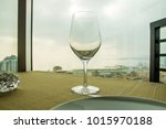 empty wine glass on the table... | Shutterstock . vector #1015970188