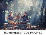 two beautiful thai women smile... | Shutterstock . vector #1015972462