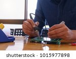 repair the electronic circuit... | Shutterstock . vector #1015977898