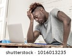 young desperate and overwhelmed ... | Shutterstock . vector #1016013235