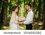 young and beautiful bride and... | Shutterstock . vector #1016032282