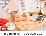 asian man wrapping purchase... | Shutterstock . vector #1016036392