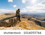woman tourist with a backpack... | Shutterstock . vector #1016055766