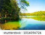 shot of beautiful lake among... | Shutterstock . vector #1016056726