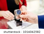 young elegant man buying wrist... | Shutterstock . vector #1016062582