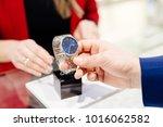 young elegant man buying wrist... | Shutterstock . vector #1016062582