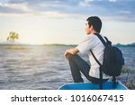 back view of travel man with...   Shutterstock . vector #1016067415